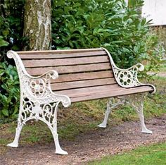 Restored Edwardian garden bench with wooden slats and cast iron frame