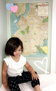 Brooklyn in front of the map of Brooklyn