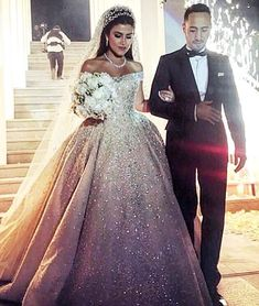 Beautiful bride @farahalali11 looked exquisite on her wedding day in a #custom #ZuhairMurad #Couture gown. She was pure perfection as she shined like a diamond in her fully beaded, off the shoulder majestic gown, a glow of happiness surrounding her and her loving groom on their special day.  #ZuhairMuradBridal