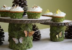Beautiful DIY Woodland Cake Stands using recycled cans, tree trunk slices from a craft store and moss. This would be perfect for a Woodland Fairy Party!