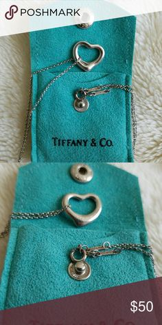 Tiffany & Co. Necklace Tiffany & Co small open heart pendant necklace in sterling silver. In good condition but needs a cleaning/polish since it's just been sitting in my closet. Comes with bag, no box. Tiffany & Co. Jewelry Necklaces