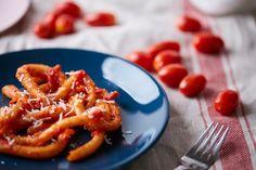 Pici pasta with tomato.