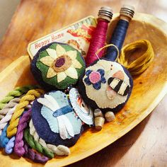 Adorable Posy Pincushions...   These pincushions were designed with the gardening and sewing aficionado in mind. Wool pincushions are decorated with nature-themed appliques. Choose from a dragonfly, sunflower, or bee applique.