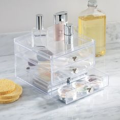3. Prevent precious containers of powders from smashing by storing them in a clear beauty cabinet we spied in Kim's bathroom on KUWTK once.
