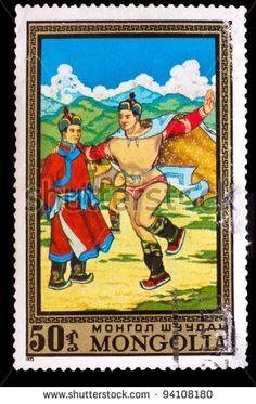 MONGOLIA STAMP CIRCA 1972: A stamp printed by MONGOLIA , Two men dance Mongolian folk dance