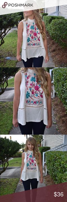 Embroidered top This knit top features a mock neck, back keyhole with buttons and embroidery detail.  -70% Rayon  -27% Polyester -3% Spandex  -Wearing size small. Tops Blouses