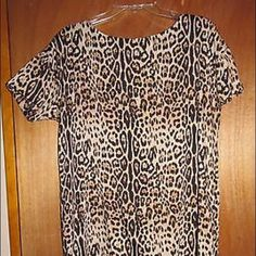 """Joe Fresh Leopard Print Dress Sz L Joe Fresh for JCPenney leopard print silky short sleeve dress - zips up the back - size large.  100% polyester - Made in China.  In excellent condition.  Measurements: Chest:  21""""  from armpit to armpit Waist:  20""""  across the front Hips:  20""""  across the front Total Length:  36"""" Joe Fresh Dresses"""