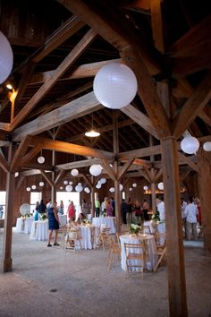 Reception idea only with pink and yellow tissue paper scrunchie balls in ceiling and string lights