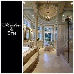 Love the French doors and ceiling, columns!! Master Bath!!  Photo by rodeoand5th