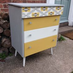 Mid Century Modern Yellow, GreyWhite Chest Of Drawers Retro Retro chest of 4 drawers, painted in Annie Sloan Paris Grey, Old White & a custom mix of English Yellow & Primer Red Co ordinating paper has been added to the top drawer and the original handles have been painted paris grey to compliment. With...