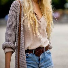 Stylish oversize cardigan, white shirt and denim shorts