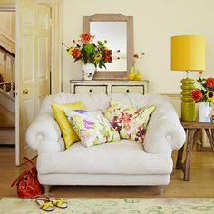 Daffodil yellow dining room with feature armchair
