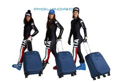 The Italian Women's team of downhill skiing with Piquadro trolleys.