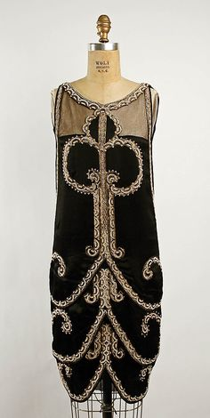 Embroidered and beaded black silk slipper satin evening gown (front) by Callot Soeurs, French, ca. 1925.