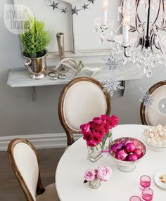 Grey Dining Room of Jessica Kelly's Toronto home looking festive with pink Christmas decorations the Holidays. See the full home tour here: http://www.sarahsarna.com/pink-christmas/