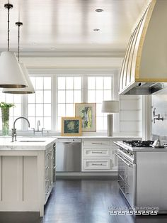 what a kitchen! | white cabinets | custom hood| island pendants | Projects @ Melanie Turner Interiors