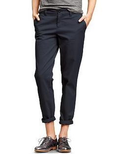 "Broken-in straight khakis from Gap, in ""blue galaxy"" ($49.95). 98% cotton and 2% spandex; machine wash. Sits below the waist. Easy through the hip and thigh, for a relaxed and casual look. Straight leg. Inseams (unrolled): 30"" regular / 27"" petite / 32"" tall."