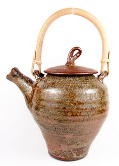 Large rustic teapot in dynamic and earthy copper brown shino ash glaze by Dock 6 Pottery. American Made. See the designer's work at the 2016 American Made Show, Washington DC. January 15-17, 2016. americanmadeshow.com #teapot, #ashglaze, #shino, #pottery, #ceramic, #americanmade, #americanmadeshow
