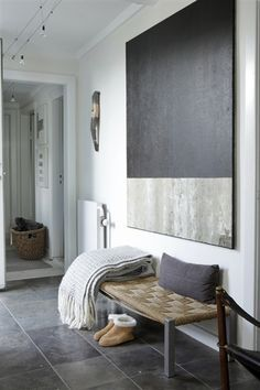 Modern art for an entryway? This could be DIY with a big piece of particle board and some paint samples.