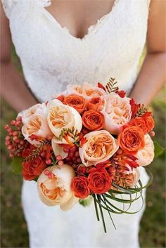 Berries, greens, coral and peach? This is the perfect orange wedding bouquet! Photo via Hitched