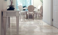 Venati Marmi series tiles in Ossigeno truly make this space. Olympia Tile, Room Tiles, Living Room Flooring, Stone Tiles, Porcelain Tile, Mosaic Tiles, Marble, Commercial, Dining Table