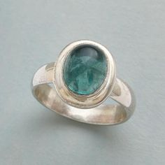 BALI TERRACE RING - A terraced sterling silver bezel upon a sterling silver band holds a dome of apatite as blue as Bali skies.