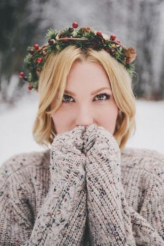 Create a festive look with knits and a foral or pine crown