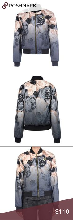 PUMA X CAREAUX FLORAL REV BOMBER JACKET XS NWT New with tags, Puma X Careaux bomber jacket that is reversible. The inside is black.  Ultra-comfy bomber jacket with allover floral-print Baseball collar Long sleeves with banded cuffs Front zip closure Two outside pockets Two inside pockets Banded hem Padding: Polyester Outer: Polyester Inner: Polyester/elastane Rib: Polyester/elastane Machine wash Imported Puma Jackets & Coats