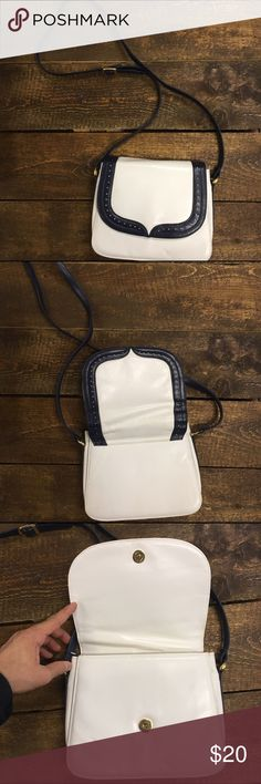 Vintage blue and off white  shoulder bag *Navy Blue trim and white interior     *Adjustable strap     *Interior functioning zipper pocket  *3 interior compartments  *Minor interior damage (photo detail)  *Gold hardware detail Bags Shoulder Bags