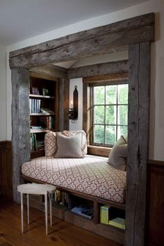 Love this window seat! Barn board framing totally makes the space!