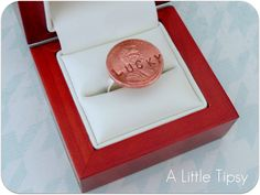 """Lucky Penny Ring. """"Find a penny pick it up and all the day you'll have good luck."""" Need: Penny*, 1/4"""" CAPITAL stamp set, 1 fine point brown permanent marker, 1 ring base (one w/ a big circle on it), & glue meant for use w/metal. Stamp """"LUCKY"""" across the front of the penny. Trace inside the letters with the marker. Quickly wipe off excess ink. Attach the penny to the ring base with the glue.  * You can use a new or old penny or a penny from your birth year."""