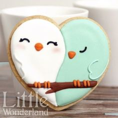 What adorable, perfect Valentine's day cookies! Sweet little love birds made with a heart cutter. cute kawaii biscuit bake to make for your sweet love on valentines day Bird Cookies, Heart Cookies, Cute Cookies, Cupcake Cookies, Cookie Favors, Flower Cookies, Easter Cookies, Fun Cupcakes, Christmas Cookies