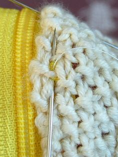 How to hand sew a zipper on a crocheted item {Zipper - the purl bee}