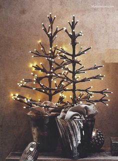 Roost Tabletop Lighted Tree - Roost  -  L266  Set your tabletop display aglow with out lighted tree. Made from floral tape wrapped wire , each branch emits soft , pleasing illumination from battery- operated low- voltage LED lights. Takes three AA batteries ( not included ). Can stand alone in the included linen bag or can be paired with our Pxidized Silver Glass Cup.