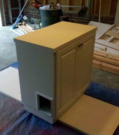 I have an old cabinet like this in our garage...maybe I could clean it up, paint it and cut a hole in it to create a hidden litter box while adding counter space in our laundry room...!