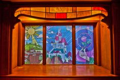 LOVE the look of the stained glass backdrops for Beauty & the Beast.