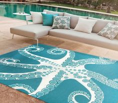 Turquoise Octo! Indoor-outdoor deep aqua and white area rug decorated with 8 reaching arms of a tentacled octopus is simply fabulous!
