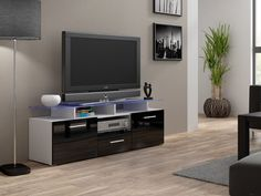 EVORA mini TV Unit is a modern tv entertainment center that will add a unusual look to your living room. It has two doors and one drawer. Glass shelf  at the top - 8 mm thick. The whole body of the stand is manufactured using high quality mdf board in matt white finish (body of the tv cabinet) and fronts black high gloss finish.