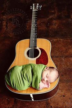 This small strummer: | 29 Newborns Who Really Nailed Their First Photo Shoot