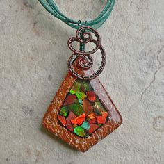 Dinosaur Bone and Ammolite Pendant  Fossil by magpiesmiscellany