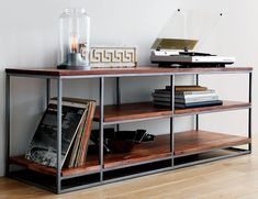 Open shelving displays flat screen up top, audio and video gadgets below. Asymmetric design features taller storage at one end to host LPs and gaming towers. Also doubles as room divider, bookcase or elevated coffee table. Media Furniture, Steel Furniture, Furniture Sale, Furniture Design, Furniture Removal, Hifi Regal, Open Shelving, Shelves, Mid Century Credenza