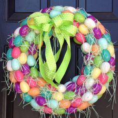 Easy DIY Easter Wreath  Hot glue plastic Easter eggs to styrofoam wreath. Use Easter grass to fill in white space. Add bow and hang.