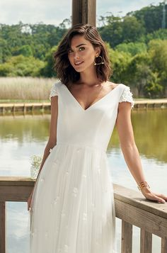 Viva Forever Wedding Dress: Long magical dress with a V neckline, open back, short sleeves, and little flowers on the sleeves and skirt. Wedding Dresses With Flowers, Stunning Wedding Dresses, Long Wedding Dresses, Short Dresses, Dress Long, Boho Wedding Dress Bohemian, Bohemian Weddings, Indian Weddings, Wedding Dress Sleeves