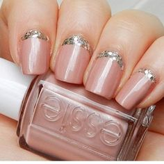 Baby pink with a touch of sparkle.  The best part?  As your nails grow glitter at the base can help extend your mani!