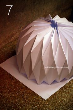 How to make an origami paper lantern. Use LED lights so you don't have to fireproof it.