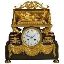 "Afbeeldingsresultaat voor ormolu mask empire French OR empire OR style OR clocks OR furniture ""ormolu"""