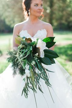 Horticulturalist-turned-florist Stephanie Karadzhov used magnolias, tulips, and trailing greenery to create this sophisticated sculptural cascade of a bouquet. | Photo by Elizabeth Marie Photos