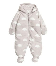 Jumpsuit in soft fleece with a printed pattern. Jersey-lined hood, and zip at front and along one leg. Feet and mittens with overlapping opening. Jersey lining.