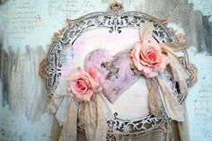 Pink puffy heart plaque roses handmade wall hanging shabby chic wooden art piece rhinestone bird embellished home decor anita spero design It measures: 23 by 20  This is a beautifully made wall piece. A grouping of roses around a handmade heavy paper mache heart . In the center is a rhinestone vintage jewelry piece (It is distressed)..what a beautiful swallow! I added the word angel to the swallow. Around the edges painted in gold there is a rhinestone band. This hangs flat to the…