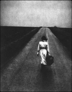A woman with suitcase. Edward Dimsdale - Road, East of England, Autumn, 1997 Black and white photo. Where Have You Gone, Nostalgia, Ex Machina, Loneliness, Solitude, Black And White Photography, Decir No, Art Photography, Contemporary Photography